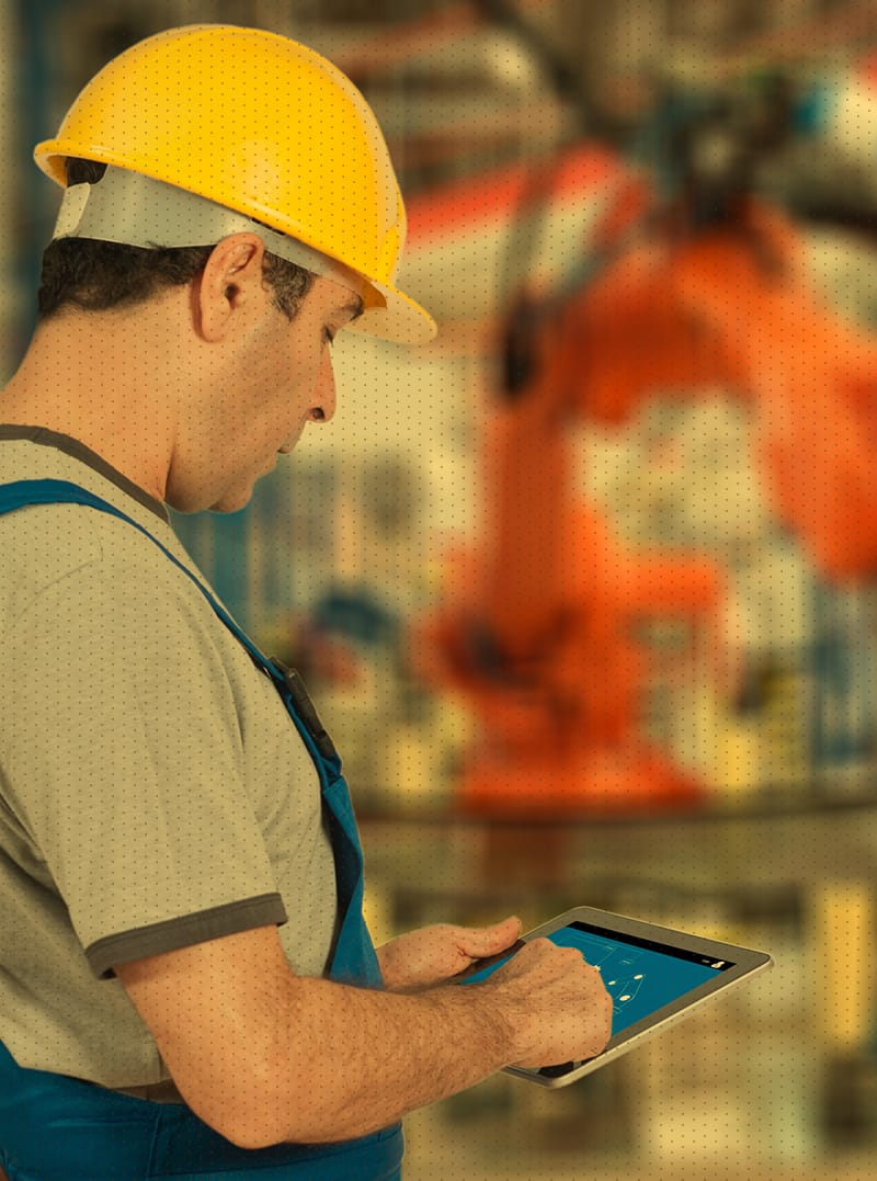 Man with yellow hard hat working in manufacturing plant