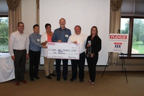 Plexus team presents check given to local charities